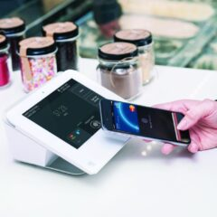woman pays with contactless Apple Pay Card Connect Paradise Clover Merchant Services Charge It Now process using credit card on POS system