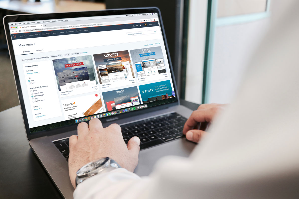 man on laptop looking for resources Card Connect Paradise Clover Merchant Services Charge It Now
